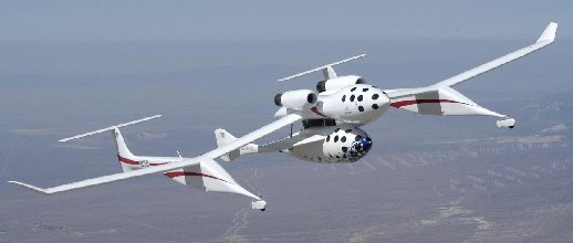 SpaceShipOne is carried to high altitude by the carrier aircraft White Knight during a test flight.